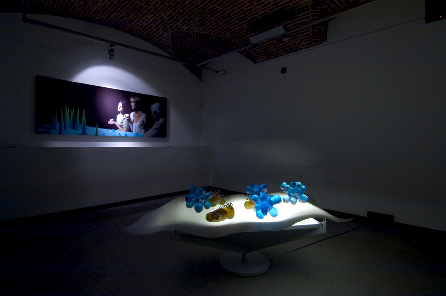 Tavolo quantico (I Mangiatori di Patate), 2005, perspex, neon, resin and pigments, installation view (project), 200 x 80 cm