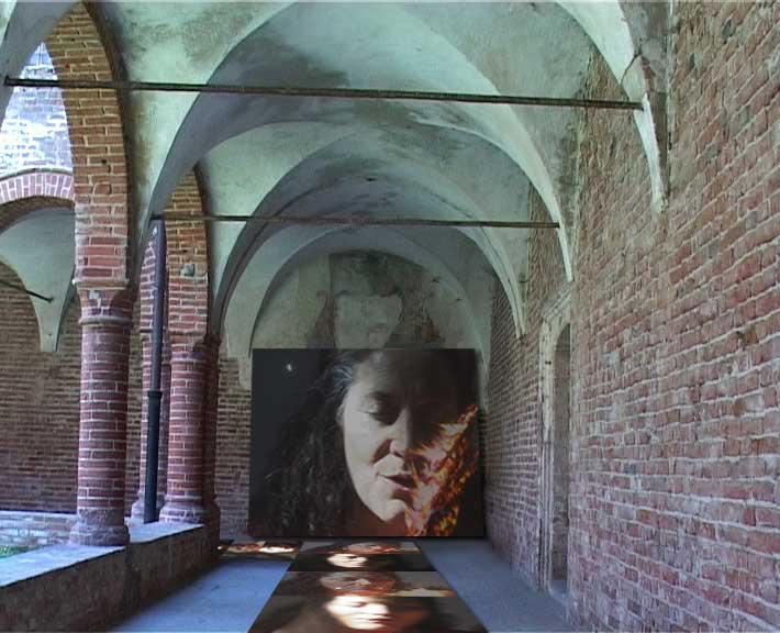 Domina Ludi, 2002, n. 2 projectors, plasma TV, digital pvc prints, video installation view (detail), Chiostro di San Domenico, Casale Monferrato, 2005 (detail)