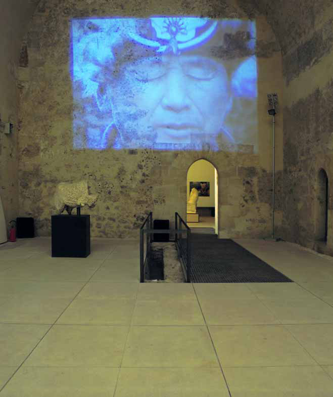 Transire, 2000, video projector, DVD, amplifiers, installation view, Castello Ursino, Catania, 2001